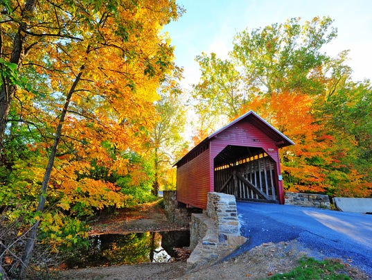 Autumn colors frame a covered bridge in Maryland