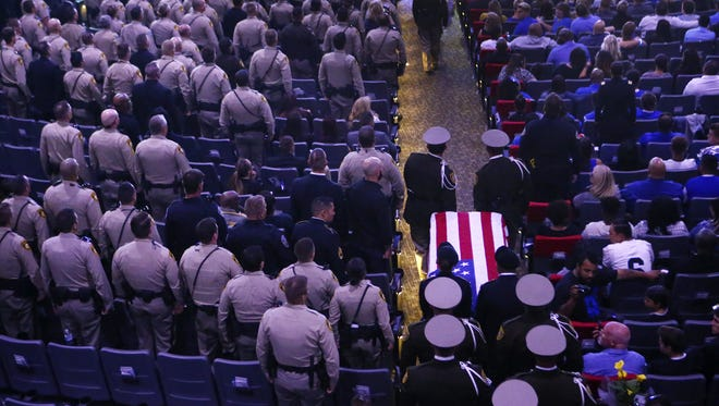 Pallbearers guide in the casket of Las Vegas police officer Charleston Hartfield during his funeral on Oct. 20, 2017 in Henderson, Nevada. Hartfield was killed by a gunman shooting from a hotel into a crowded outdoor concert on October 1 in Las Vegas.