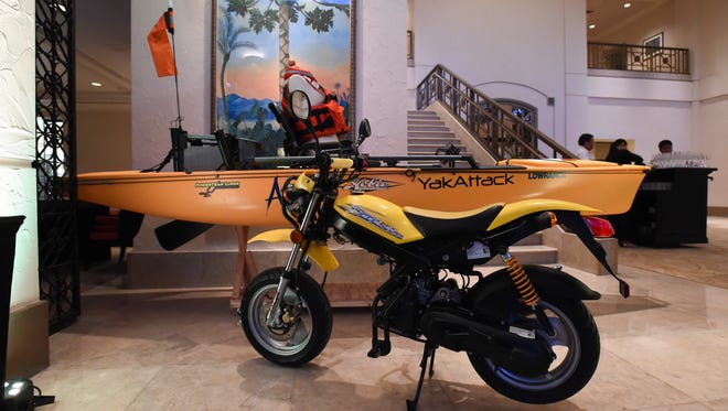 A dirt bike and kayak were available for a silent auction at the Archbishop Anthony Sablan Apuron's $200 plate, 70th birthday party at Hyatt Regency Guam in Tumon on Nov. 1.
