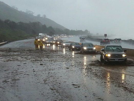Mud and debris flows near La Conchita closed down northbound