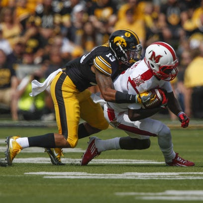 Iowa cornerback Greg Mabin, tackling a Miami of Ohio