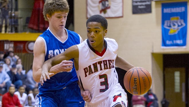 North Central High School junior Wes Stowers (3) races the ball past Hamilton Southeastern High School senior Eric Davidson (30) during the first half of high school varsity basketball action Saturday, Dec. 21, 2013, at North Central High School.