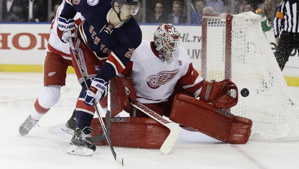 Red Wings goalie Jimmy Howard (35) stops a shot as
