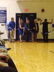 Lambuth faculty members cut a ribbon Saturday in rededication of the Health & Wellness Building at True Blue Day.