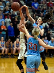 Courtlyn Beaven of Union County blocks a shot by Karlie Keeney of Webster County during the Girls district 6 game at Webster County High School in Dixon Monday.