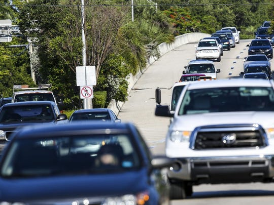 Traffic filters into Fort Myers from Cape Coral Friday morning at the base of the Midpoint Bridge. According to Census figures, Cape Coral-Fort Myers has longest mean travel time to work in stte: 28 minutes.