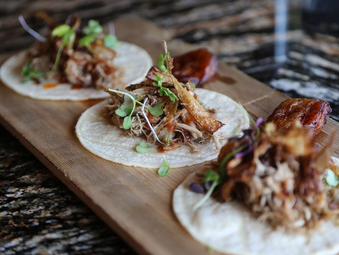 Duck carnitas tacos with guava chipotle sauce and crispy
