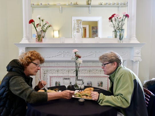 Donna Stroble and Betsy Uffelman, both of York, eat