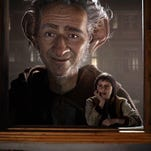 """This image released by Disney shows Ruby Barnhill in a scene from""""The BFG."""" (Disney via AP)"""