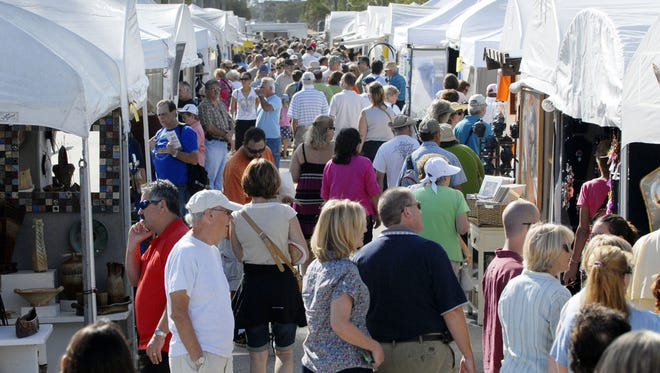 The 48th Annual Space Coast Art Festival was Saturday and continues through Sunday at the intersection of SR A1A and Minutemen Causeway. Crowds check out the artwork on Brevard Ave.