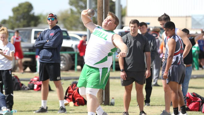 Wall High School's Chad Glasscock gives it his all in the shot put competition at the Cotton Patch Relays in Wall on Thursday, March 29, 2018.