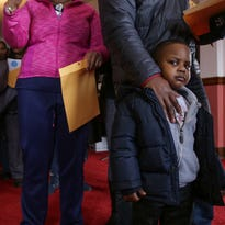 Jaylen Smith 4 of Flint waits in line with his father Keith Sanders 25 of Flint to have blood samples taken to be tested for lead on Saturday January 23, 2016 at the Masonic Temple in downtown Flint. Smith goes to family members houses outside of the city of Flint for water relief.  The free lead level testing event for children and adults was sponsored by The Sanders Law Firm to help Flint residents dealing with the Flint water crisis to find out how they've been effected.