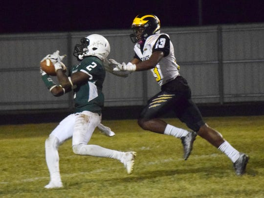Peabody's Kadarian Ellis (2, left) catches a 41 yard pass ahead of St. James' Glen Brown (13, right) in the first round of the LHSAA Class 3A playoffs held Friday, Nov. 11, 2016.