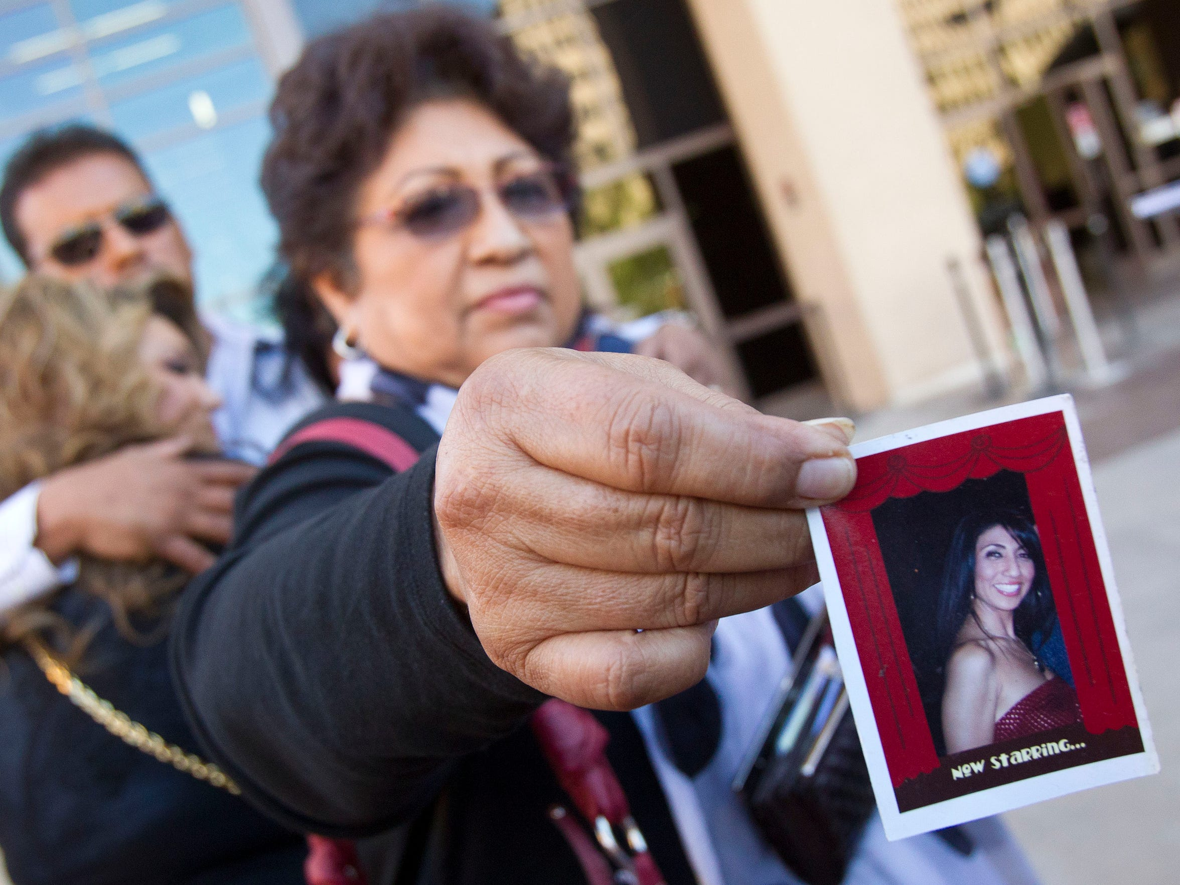 Maria Nuñez, mother of Sophia Nuñez, holds up a photo