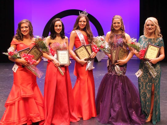Jessie Besanson of Carriere, center, was crowned Miss