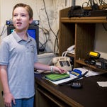 Sam Haviland, 9, speaks to a fellow user using amateur radio, or ham radio, at Abbeville General Hospital.