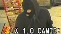 Security camera image of a man wearing a ski mask   who robbed a 7-Eleven store at 8901 Diana Drive.