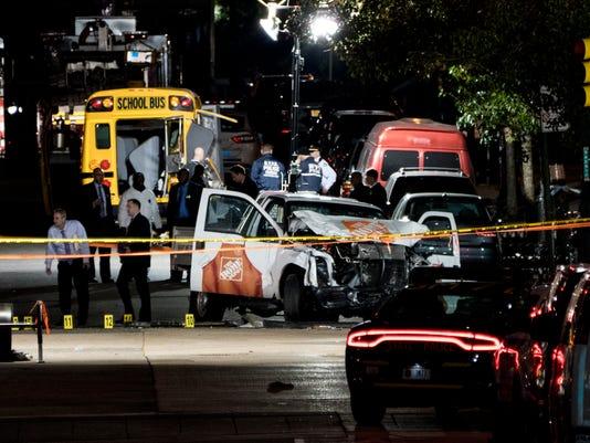 Ap Manhattan Shooting A Usa Ny Authorities Stand Near Damaged Home Depot Truck