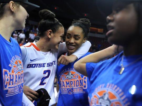 Boise State's Shalen Shaw, left, hugs teammate A'Shanti