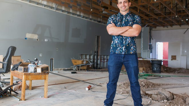 James Christensen, co-founder of Territory Dispensary, stands in what will become Chandler's second medical marijuana dispensary.
