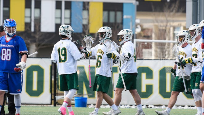 Vermont celebrates a goal during the men's lacrosse game between there UMass Lowell Riverhawks and the Vermont Catamounts at Virtue Field on Saturday afternoon April 7, 2018 in Burlington. (BRIAN JENKINS/for the FREE PRESS)