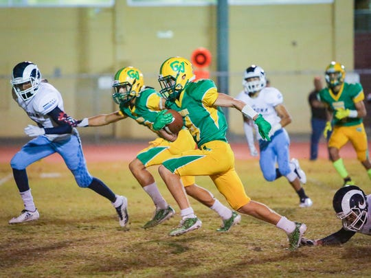 Angelo Fitzgerald runs the ball midfield for a touchdown. The Coachella Valley varsity football team won Friday's home playoff game against Ramona by a score of 45-7. This is the first home football playoff game for the Arabs since 1988.