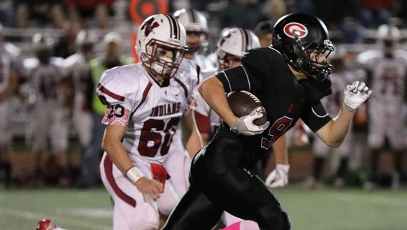 Rye's Billy Chabot gains some yards during their game