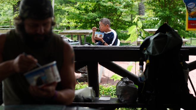 Young Shu Li, who splits his time between Brooklyn and Chine, eats a half gallon of ice cream at the Pine Grove Furnace State Park General Store. Li recently retired and decided to take on the Appalachian Trail.