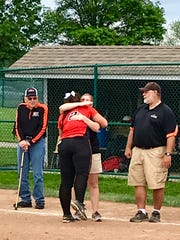 North Union senior Avery Clark and head coach Dawn Draper hug after winning the Division III district championship this season. North Union is making its seventh trip to the state tournament in program history.
