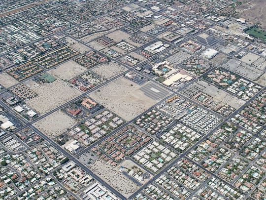 An aerial view shows the checkerboard pattern where development and non development are side by side in certain areas of Palm Springs.