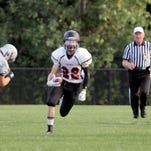 Griffin Peterson, seen returning a kick during the first quarter Friday, had five catches for 41 yards and a touchdown in Saturday's 39-36 overtime loss to Plymouth.