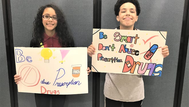 """Gabriela Cumba, for grade school, (left) and Xavier Lugo, for middle school, are the winners of the Boys & Girls Club of Vineland's SMART Moves billboard contest, """"Be SMART, Don't Abuse Prescription Drugs."""""""