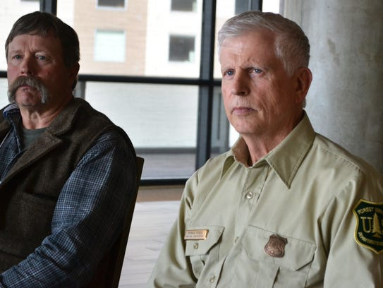 U.S. Forest Service Chief Tom Tidwell, center, listens