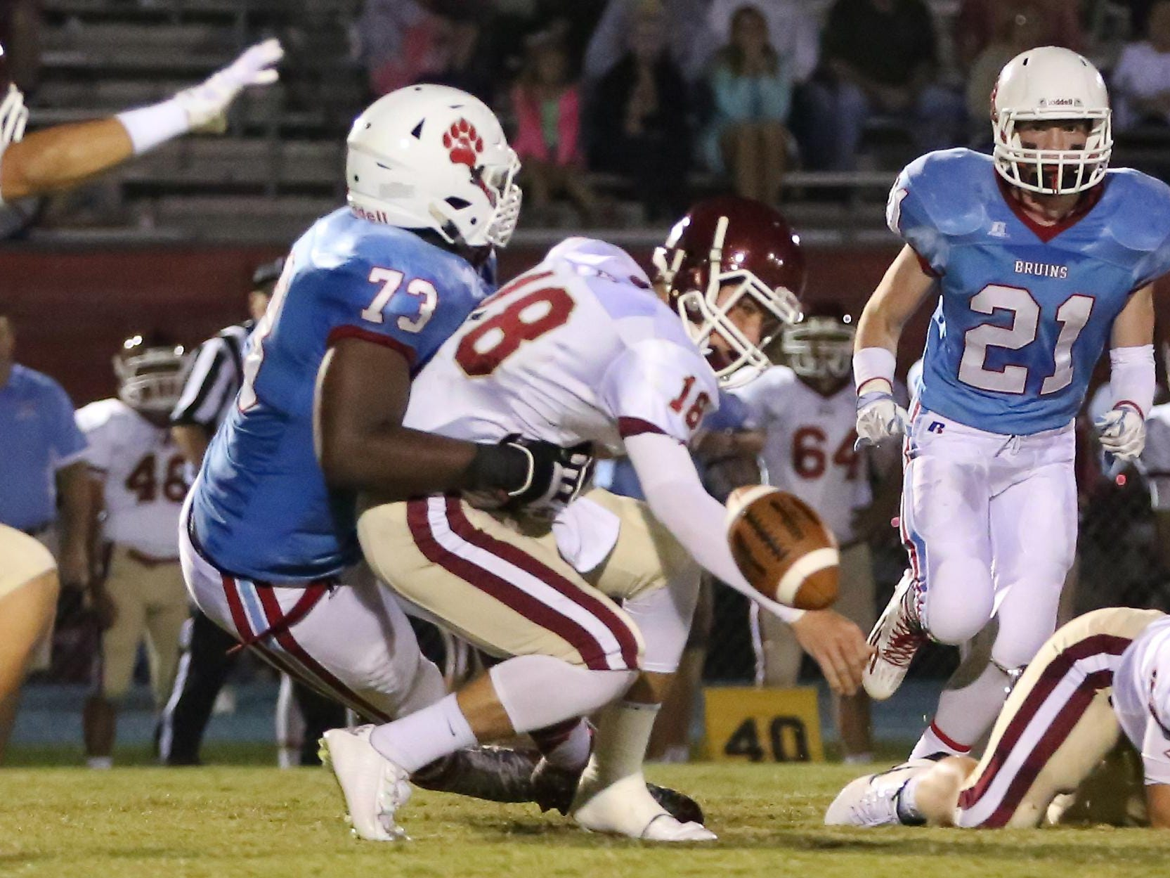 University School of Jackson's Trey Smith forces a quarterback fumble during their game this year against Evangelical Christian School.