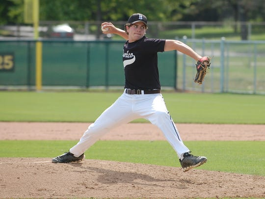 Luke Smith of Delran delivers a pitch for Burlington