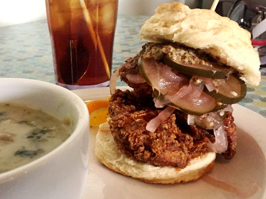 Indulgence Bakery and Cafe's Boxcar Chicken Biscuit with seasoned fried chicken, homemade bread and butter pickles, red chile honey and whole grain mustard on their buttermilk biscuit ($10.50). All sandwiches are served with homemade french fries. Substitute soup or a side salad for $1.50.