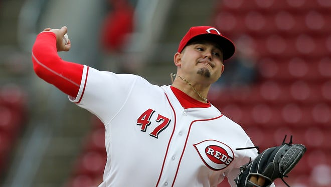 Cincinnati Reds starting pitcher Sal Romano (47) delivers a pitch in the top of the second inning of the MLB National League game between the Cincinnati Reds and the Atlanta Braves at Great American Ball Park in downtown Cincinnati on Monday, April 23, 2018.