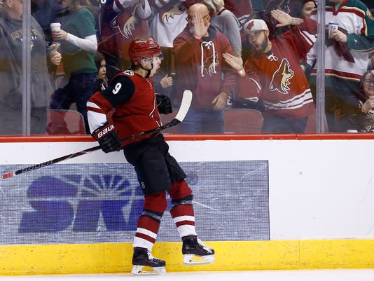 Arizona Coyotes center Clayton Keller celebrates his goal against the Minnesota Wild during the second period of an NHL hockey game Saturday, March 17, 2018, in Glendale, Ariz. (AP Photo/Ross D. Franklin)