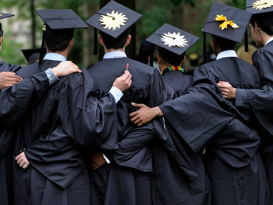 Report: Americans borrowing less to pay for college