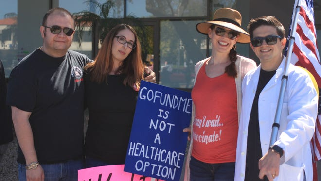 Demonstrators lined Camelback Road in Phoenix on Feb. 25, 2017, to protest the potential repeal of the Affordable Care Act.