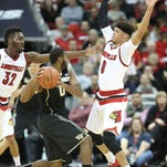 Wake forest's Codi Miller-McIntyre is trapped in the backcourt by Louisville's Chinanu Onuaku, left and Damion Lee. Jan. 3, 2016.