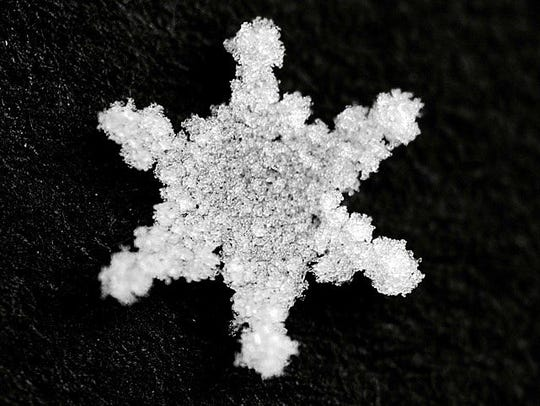 Although this perfect flake is symmetric, not all snowflakes