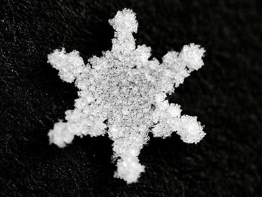 Although this perfect flake is symmetric, not all snowflakes follow that pattern.