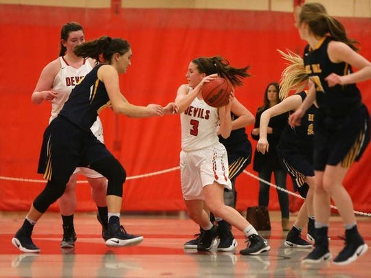 Sarah Kolody of Hunterdon Central giths through traffic Saturday vs. Del Val