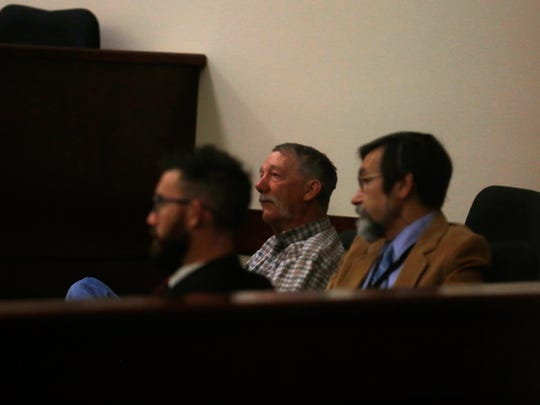 Bloomfield City Attorney Ryan Lane, left, City Councilor DeLaws Lindsay and City Manager Eric Strahl listen during a hearing  Wednesday at Aztec District Court.
