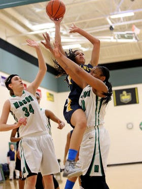 Walnut Hills standout Arielle Varner drives to the hoop against Mason in a game from January 2015.