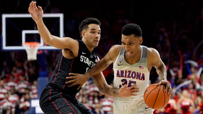 Arizona guard Allonzo Trier drives past Stanford guard Dorian Pickens at McKale Center in Tucson on Jan. 7, 2017.