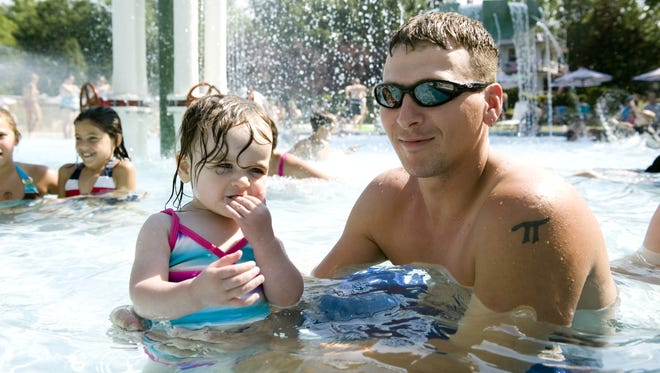 File: J.D. Py of Westmont hangs out with his daughter Meghan Py as they cool off in the water at Crystal Lake pool.