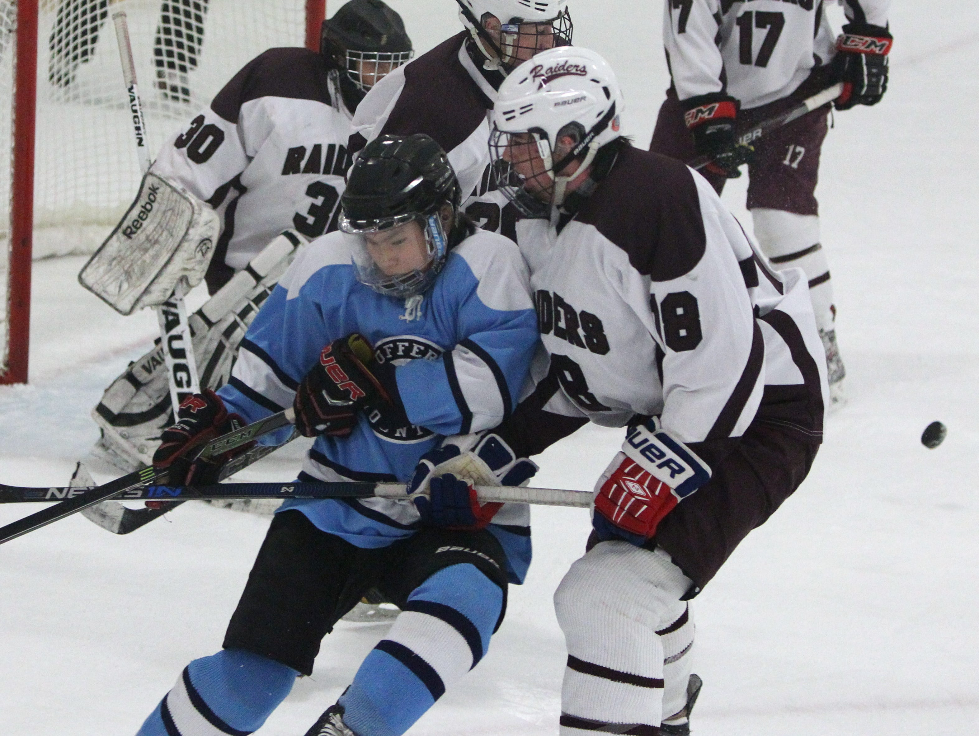 Suffern's Evan Cama, left, is pressured by Scarsdale's Martin McDonald during their game at the E.J. Murray rink in Yonkers Dec. 7, 2015. Scarsdale won 1-0.
