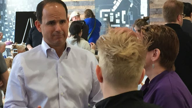 """Marcus Lemonis, star of the CNBC show """"The Profit,"""" consults with 240Sweet owners Alexa Lemley and Samantha Aulick on Saturday, April 11, 2015, at Indy City Market's Winter Farmers Market. The company is among nine small businesses that CNBC announced would appear on The Profit's third season, starting May 12."""